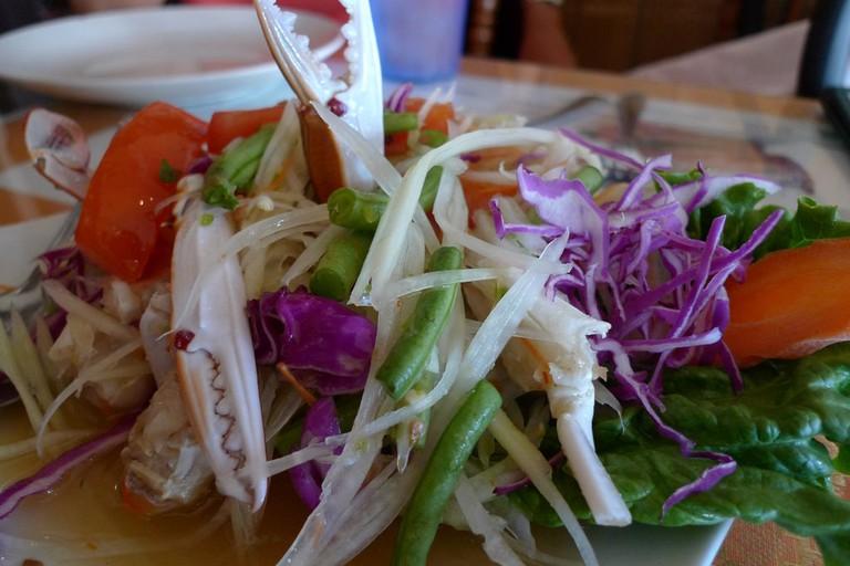 Colourful spicy papaya salad with crab