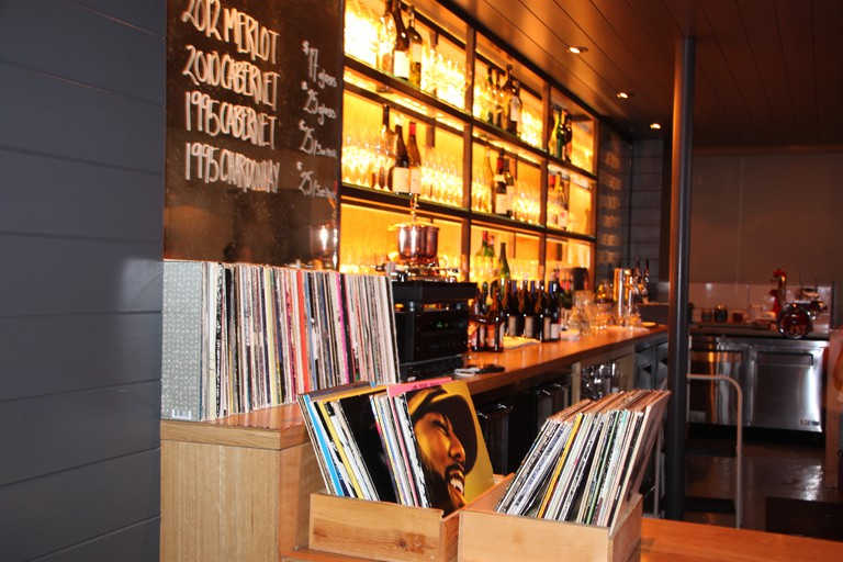 The Cadet Bar and selection of Vinyl waiting for you to buy a bottle.