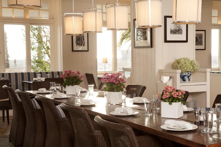 Coast's indoor dining overlooking the ocean