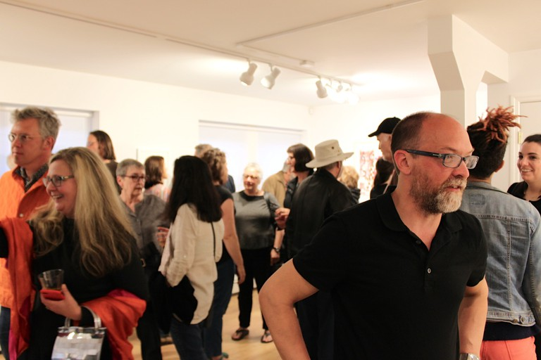 People gather at an art gallery in Beacon