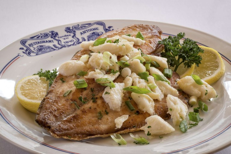 Antoine's grilled filet of pompano with crabmeat