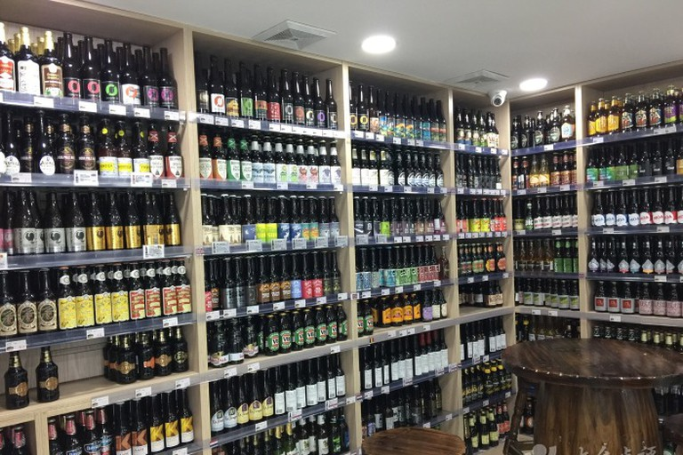 200 imported craft bottle varieties line the shelves at Beer Lady