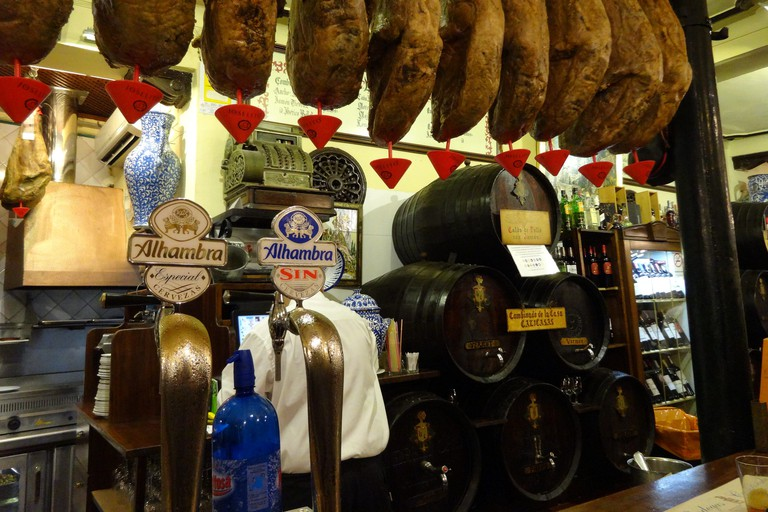 Drink vermouth with the locals and dodge hanging legs of jamon at Bodega Castañeda