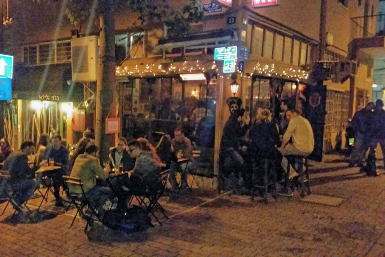 Locals and tourists rub shoulders at the Norman Bar, Tel Aviv