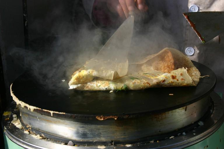 Cooking a jian bing