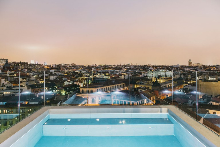 The pool and rooftop view at the Dear Hotel