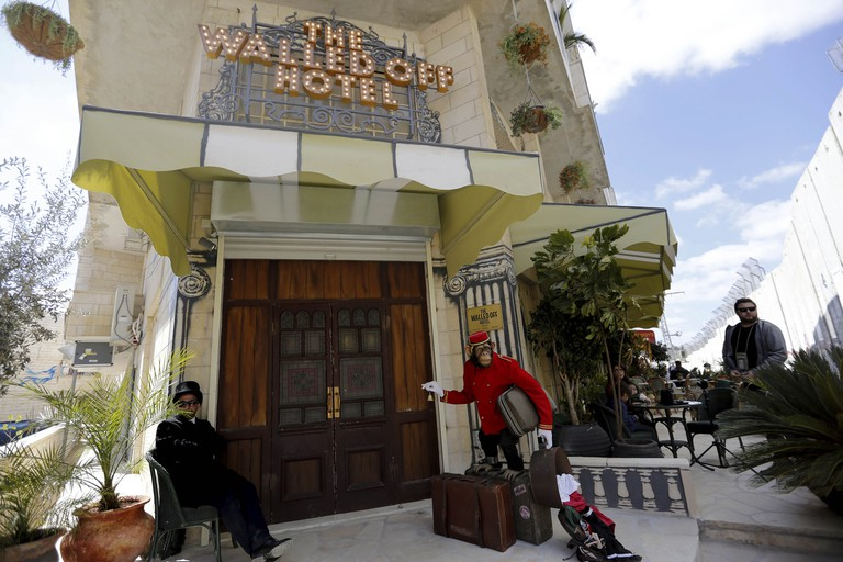 A view of the entrance of British street artist Banksy's Walled Off Hotel in the West Bank city of Bethlehem