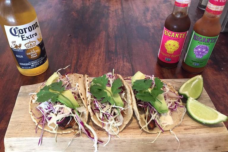 Blackened mahi-mahi tacos, beer, and local hot sauce