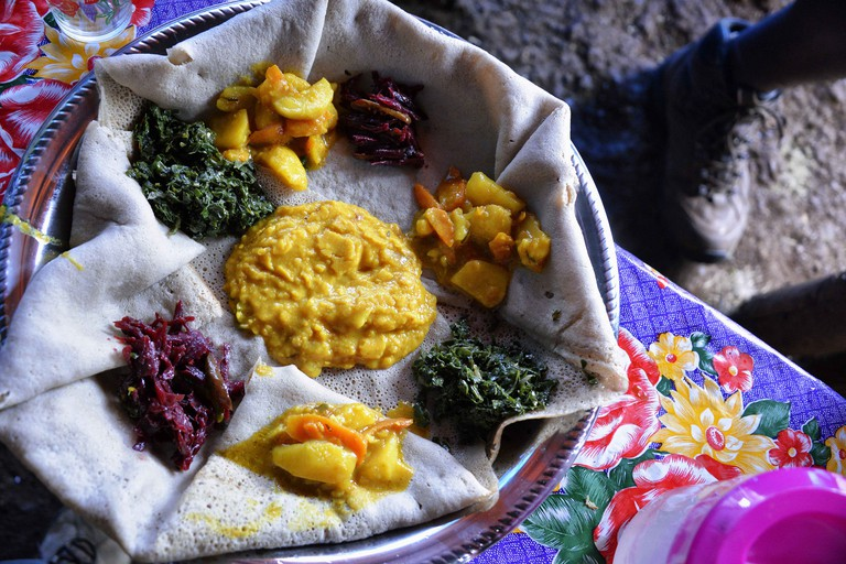 Ethiopian food is eaten off a large flat bread
