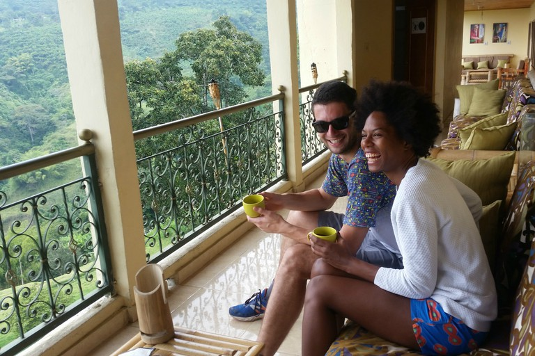 Guests enjoying specialty coffee and stunning views at Panorama Cafe Hostel