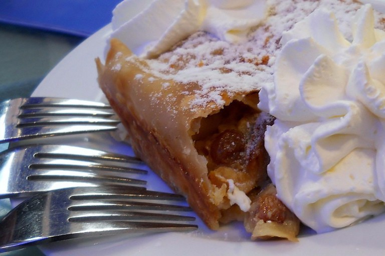 Apple strudel with a generous helping of whipped cream