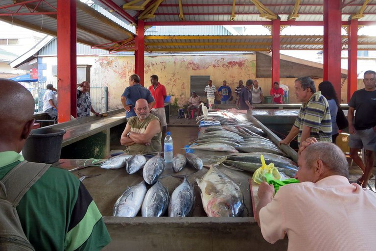 Fish mongers in the Sir Selwyn-Clarke Market in Victoria, Seychelles.