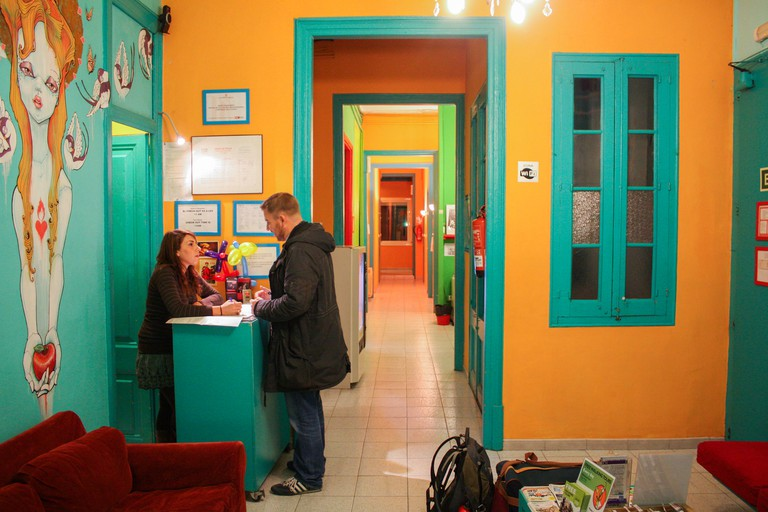 Check in at the Hostal Paraiso