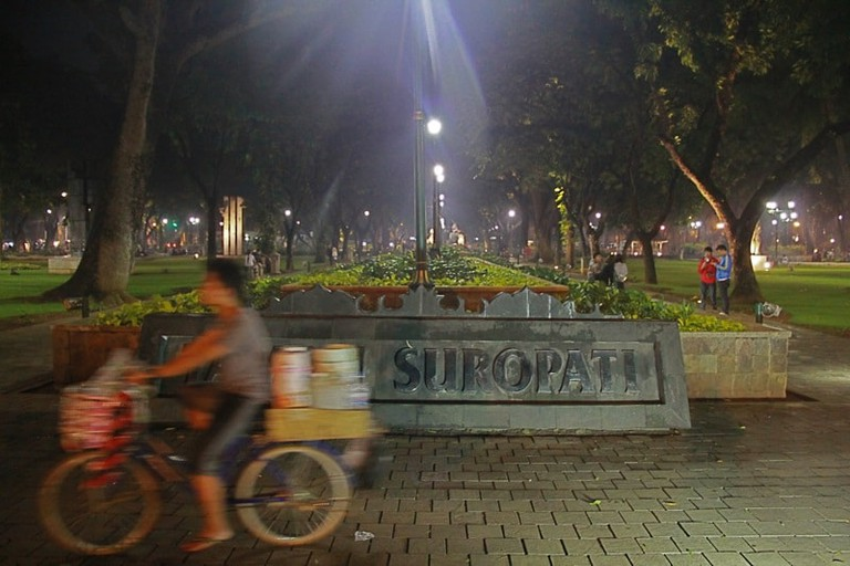 Taman Suropati at night