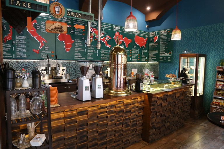 The focus on world travel through coffee is Cafe Frei's consistent look