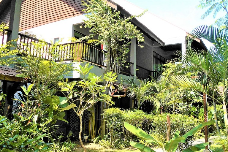 Villa Molek surrounded by tropical trees and plants