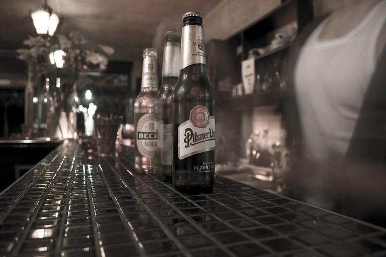 Bartender serves Beer