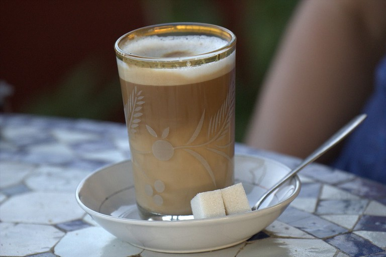 Glass of Moroccan coffee with sugar lumps