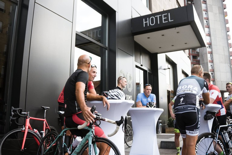 A group of cyclists enjoying 88 Rooms Hotel