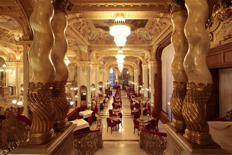 The ornate interior of New York Cafe in Budapest