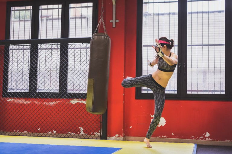 Woman practicing her kicks