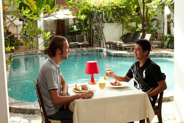 Diners enjoy a meal at Rambutan