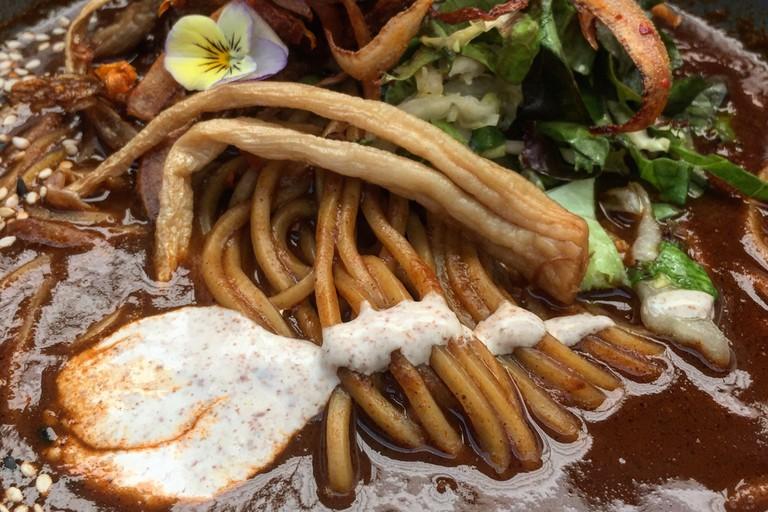 Mole Ramen with handmade noodles and cashew cream