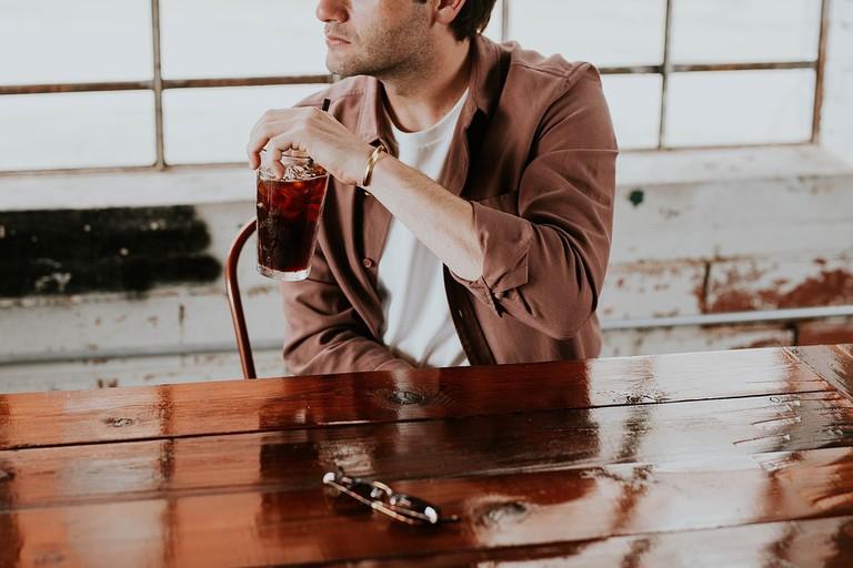 a man drinking at a bar