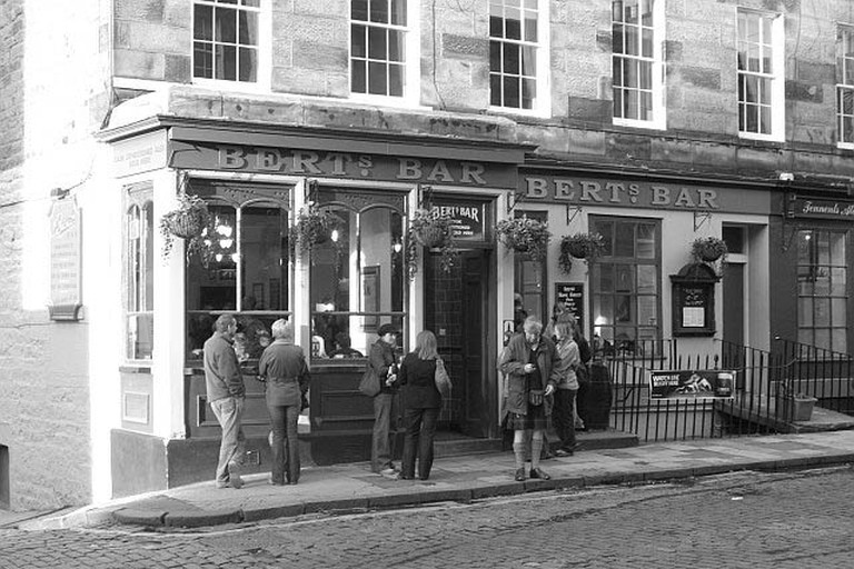 People gather at Bert's Bar, just off Princes St.