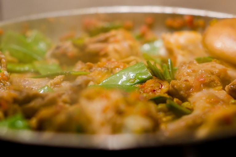 Vegetables, rabbit and chicken are the base for traditional Valencian paella