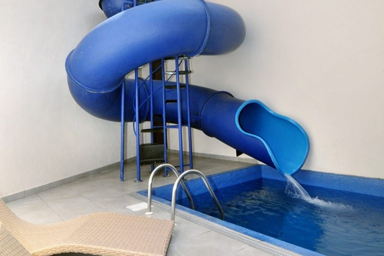 Swimming pool with slide inside the suite