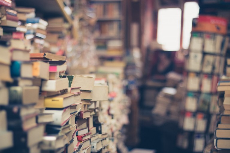 Hundreds of stacked books