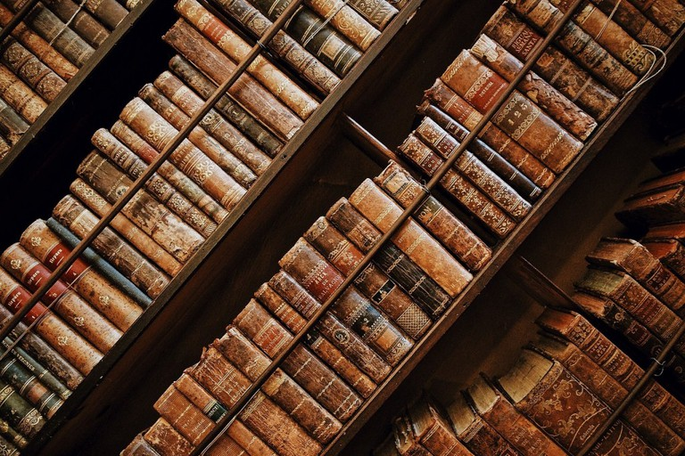 Shelves of rare books as seen from an odd angle