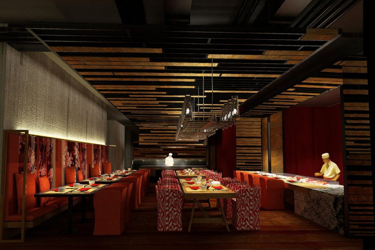 The atmospheric dining room at the Red Oven, Sofitel So Bangkok