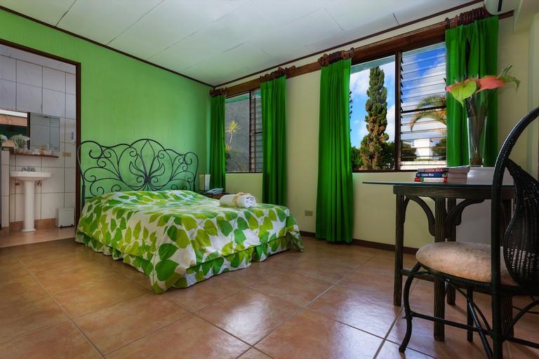 Inviting room at the Boutique Hotel Casa de las Orquideas