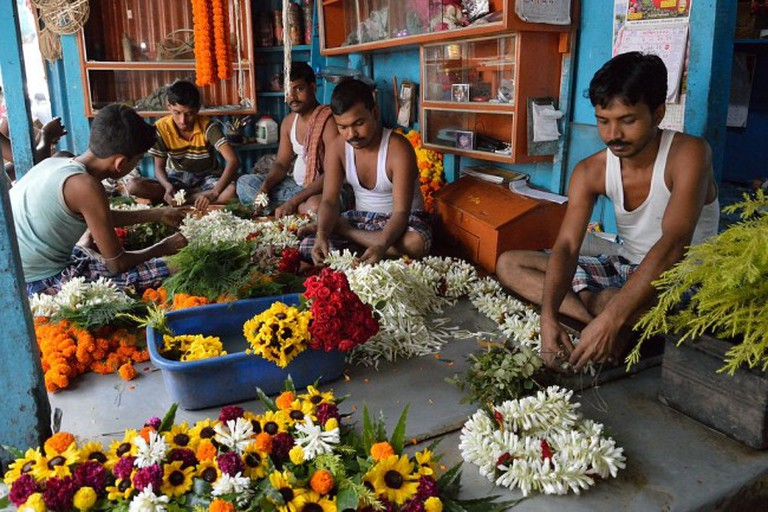 The Mallick Ghat Flower Market sells flowers and garlands sourced from around India