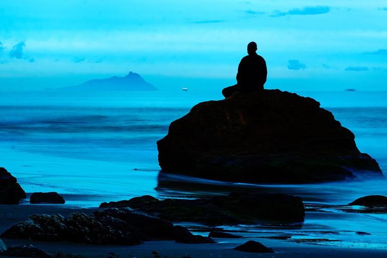 Meditating on a rock