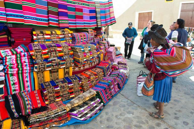 Cholita checking out some handicrafts
