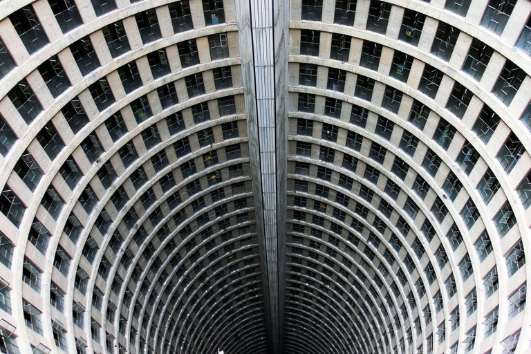 The tall building is a hollow cylinder on the inside surrounded by spiralling hallways