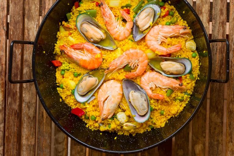 Seafood Paella in black pan - traditional spanish rice dish