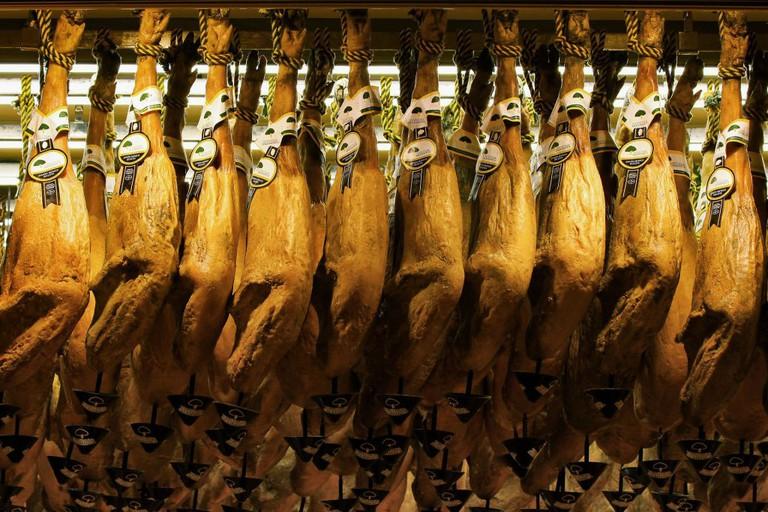 Jamón hanging in a Madrid market