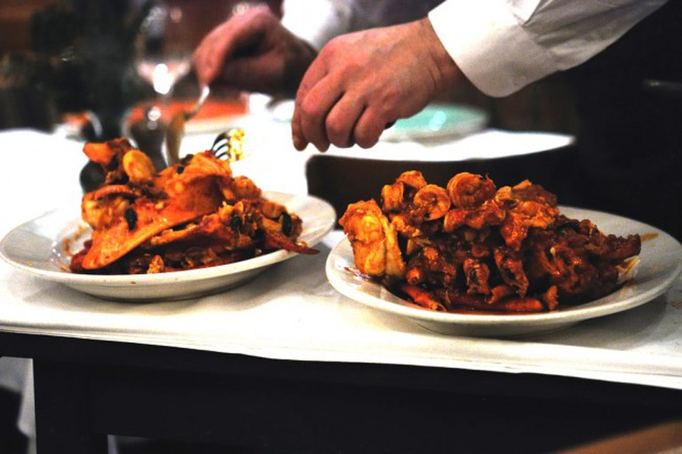 A chef prepares lobster diavolo