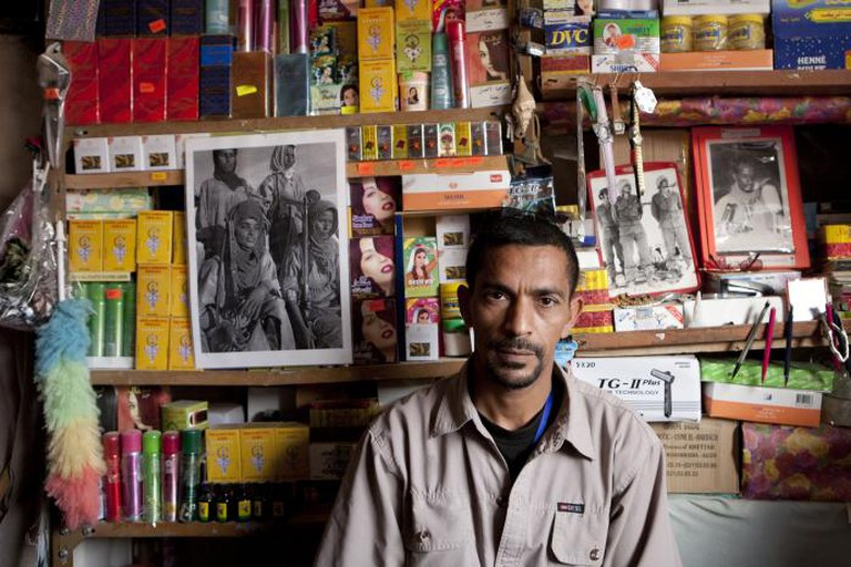 'Man in a shop'. 'Africa's Last Colony: 40 Years Not Forgotten'