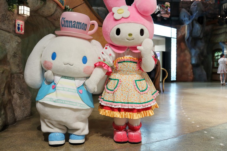 Cinnamoroll and My Melody wave hello at Sanrio Puroland