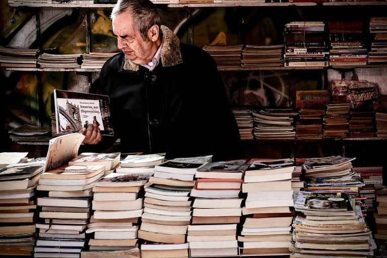 A customer wandering in a bookstore looking for old books