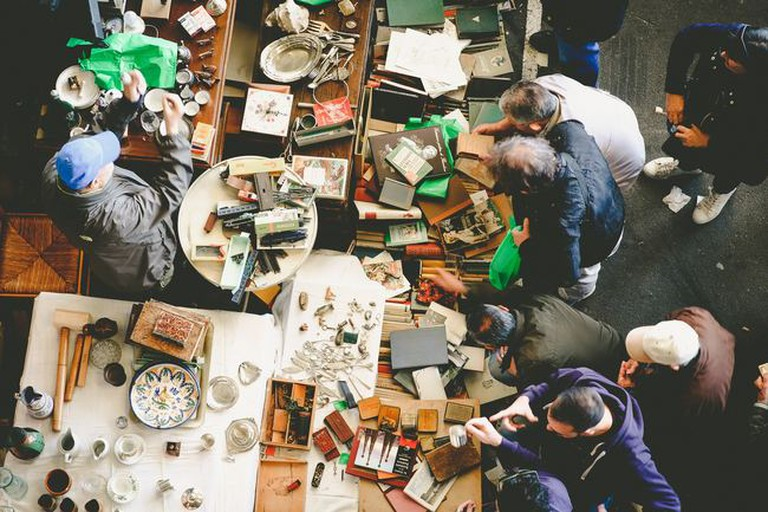 Shoppers looking for hiddens gems at a flea market