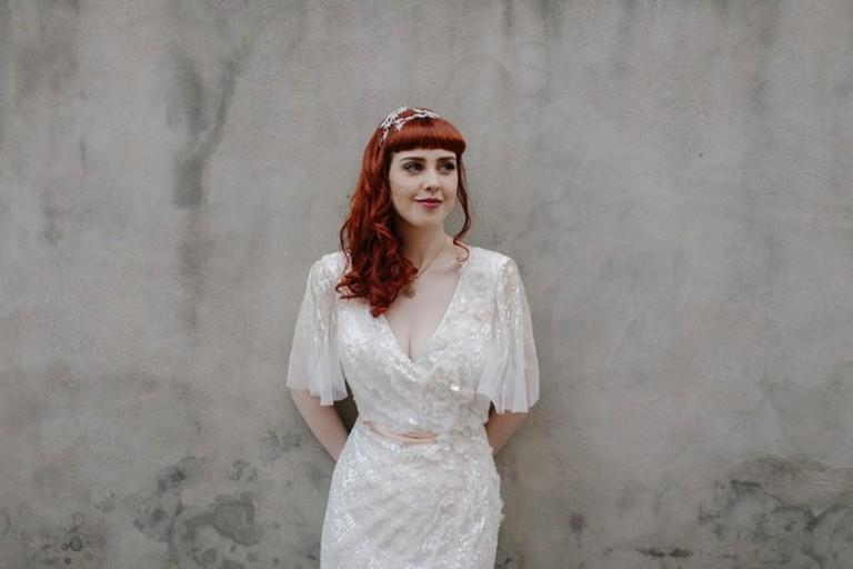 A bride wearing a vintage wedding dress