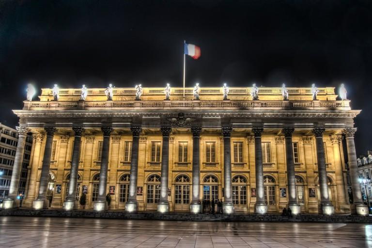The Opéra National de Bordeaux-Grand Théâtre lit at night