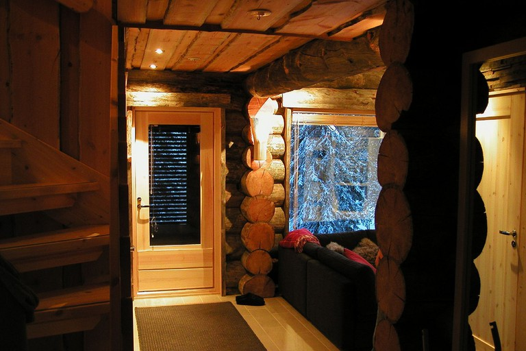 The cosy interior of a log cabin