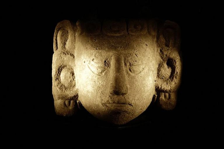 Maya stone head